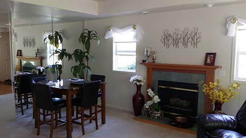 senior_home_inside_living_dining_fireplace.jpg